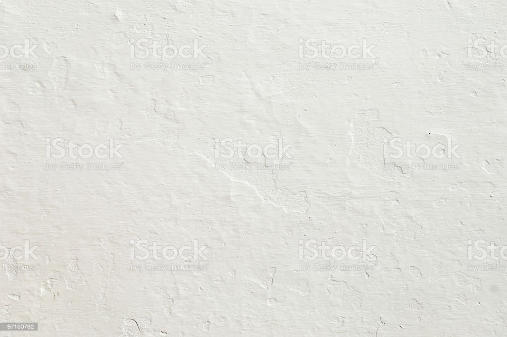 Rugged white painted concrete wall stock photo