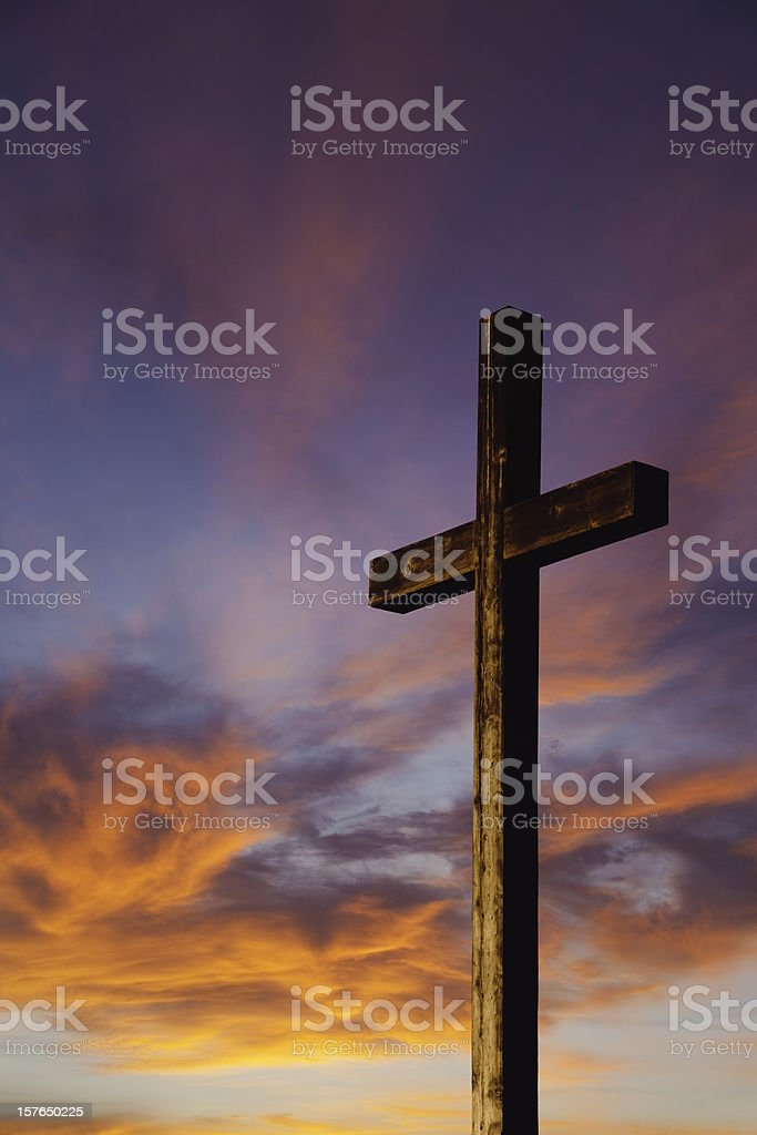 Rugged Wooden Cross Against Sunset Sky Stock Photo