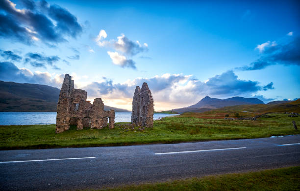 A ruin by a lake near Ardvreck castle. A ruin by a lake near Ardvreck castle, along the north coast 500 during a sunset. north coast 500 stock pictures, royalty-free photos & images