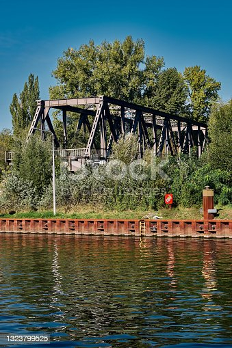 """istock Ruin of a railroad bridge, part of the abandoned Berlin """"Siemensbahn"""", at the banks of river Spree 1323799525"""