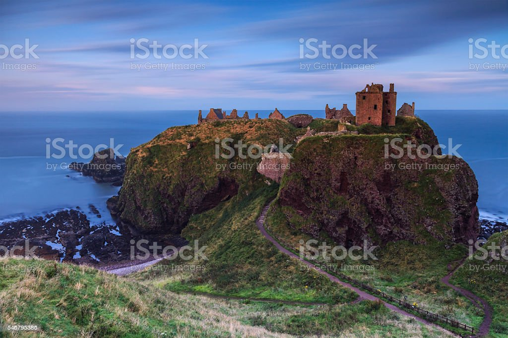 Ruin of a Scottish castle at dusk stock photo