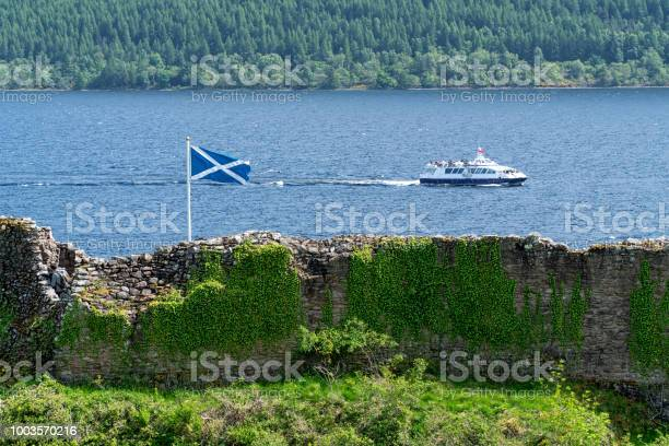 Ruin wall and flag against boat on loch ness in scotland picture id1003570216?b=1&k=6&m=1003570216&s=612x612&h=aficz4axnmrgflmavjcldsaskkoir1rygcstcfrih a=