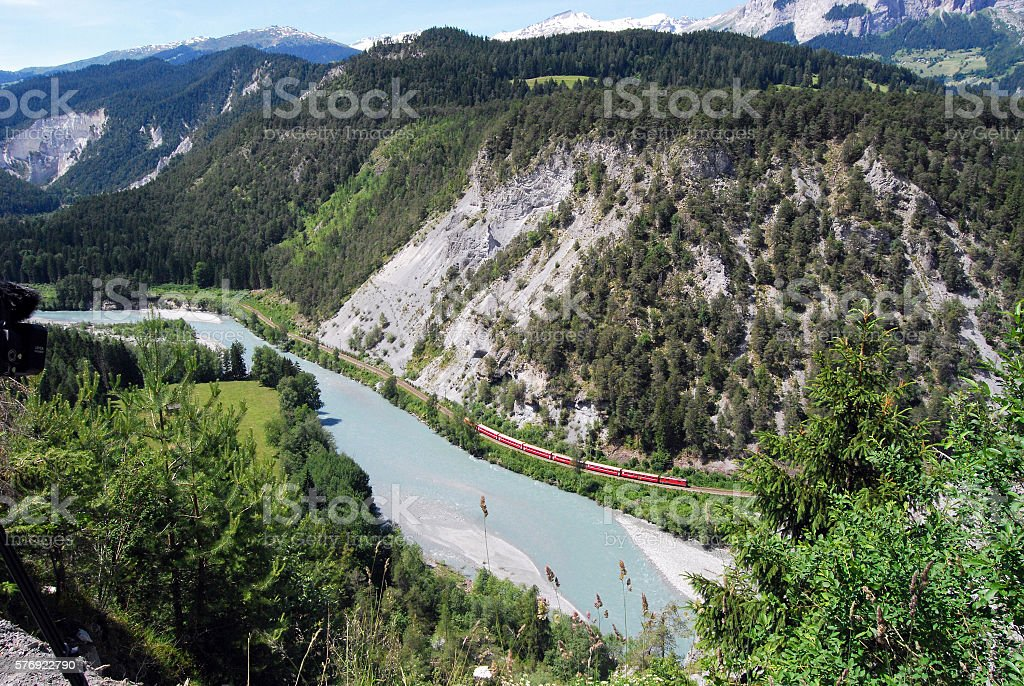 Ruinaulta/Rheinschlucht 10,000 years ago, 10 billion cubic metres of rock thundered into the valley. This event created the Ruinaulta, a canyon-like gorge in the Anterior Rhine Valley.In the gorge a train of the Rhaetian Railway (RhB) Canyon Stock Photo