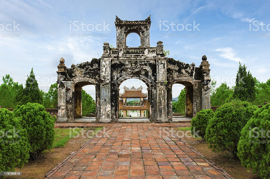 Ruined ancient gate in Temple of Literature at Hue stock photo
