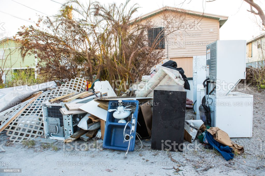 Ruined appliances, furniture and personal property are placed on the street for trash pickup in aftermath of hurricane in Cudjoe Key, Florida stock photo