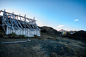 istock Ruined bleached camp huts on volcanic mountain with bule sky 526786221