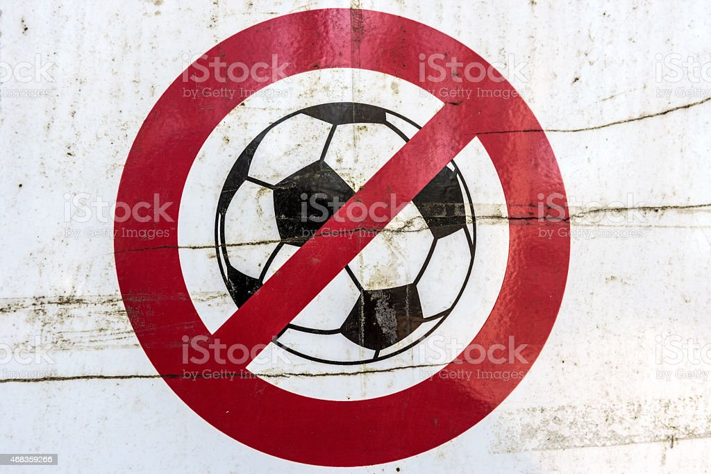 Ruined, broken, and dirty sign. No Football!!! royalty-free stock photo