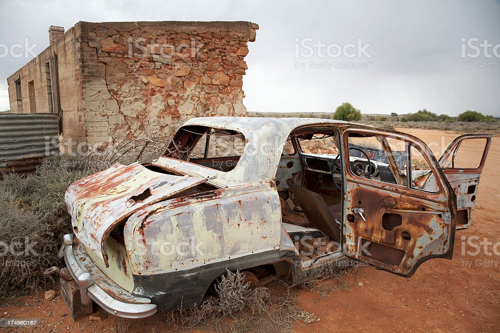 Ruined building and rusted car body in Silverton, Australia stock photo
