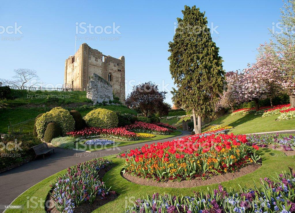 Ruined castle in English garden stock photo