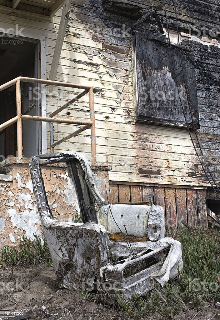 Ruined Chair Outside Burned Building royalty-free stock photo