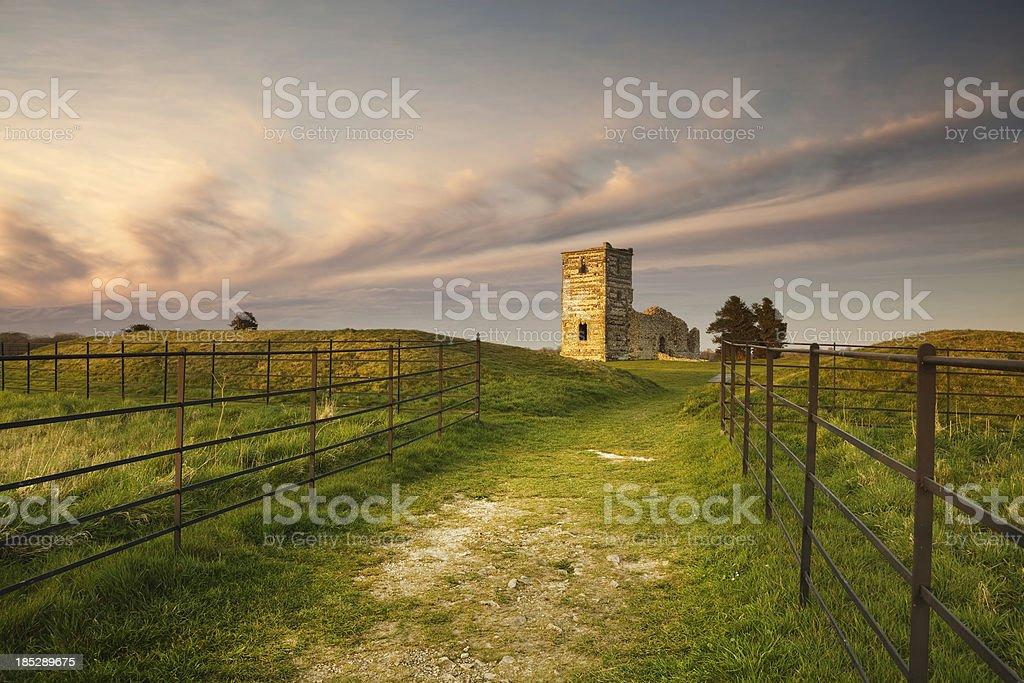Ruined church at sunset stock photo