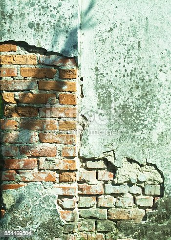 istock Ruined cracked wall of the old house. Grunge texture. Stock Photo for background 854469504