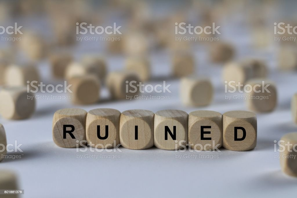 ruined - cube with letters, sign with wooden cubes stock photo