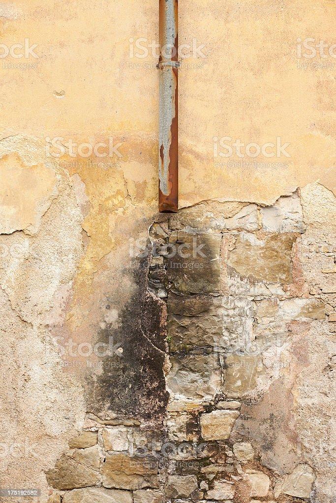 Ruined Facade (Broken Drainpipe) stock photo