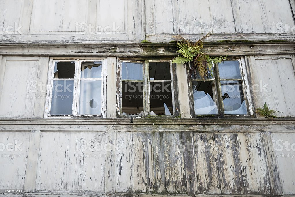 ruined house fassade with broken windows royalty-free stock photo