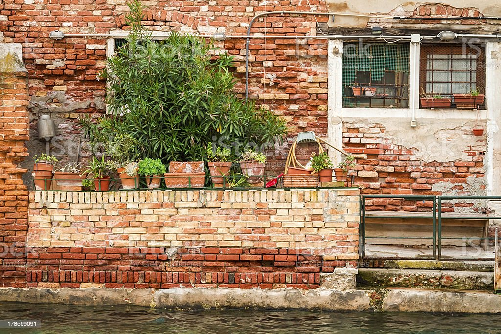 Ruined house on a canal in Venice royalty-free stock photo
