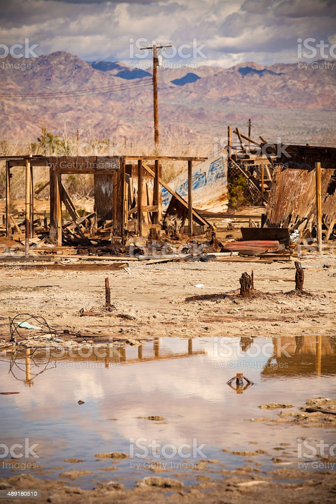 Ruined Houses and Standing Water in Desert Ghost Town stock photo