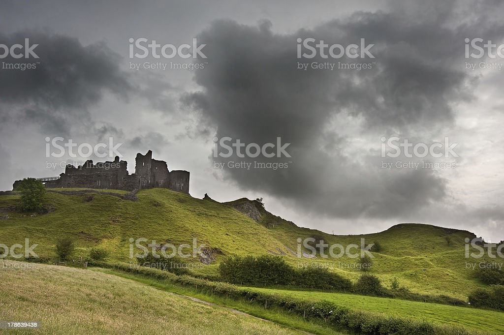Ruined medieval castle landscape with dramatic sky royalty-free stock photo