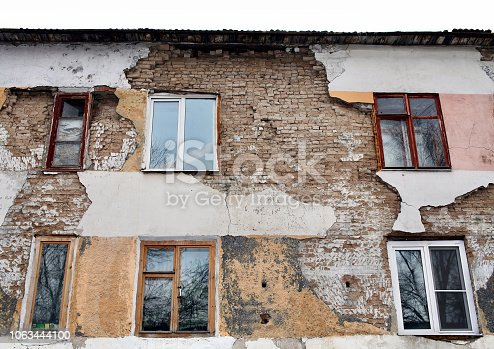 istock Ruined old living brick houses 1063444100