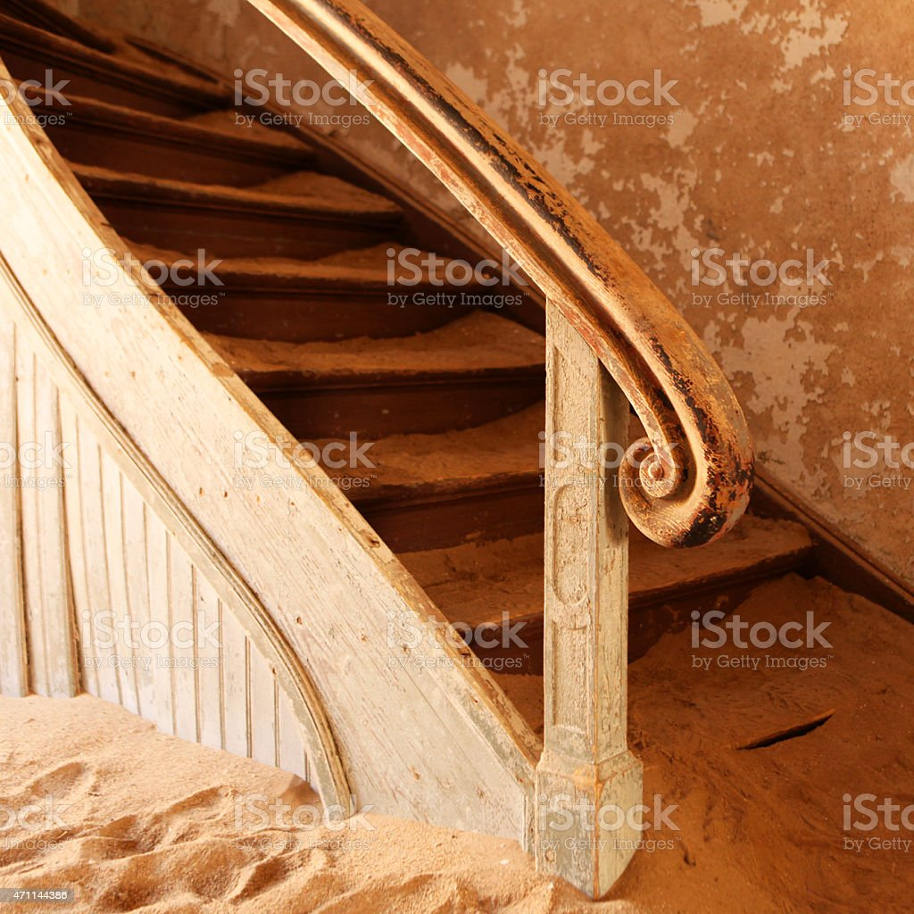 Ruined Old Wooden Staircase in an Abandoned House in Kolmanskop stock photo