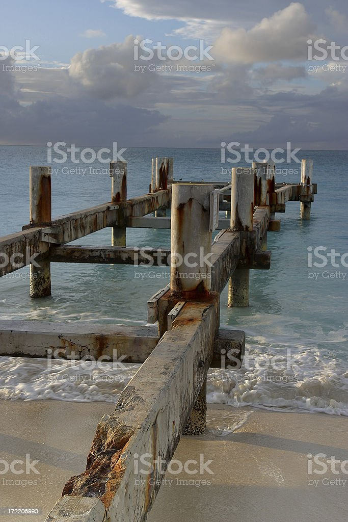 Ruined Pier at Grace Bay stock photo