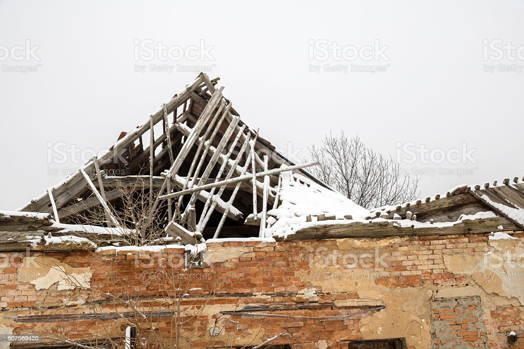 Ruined roof under snow stock photo