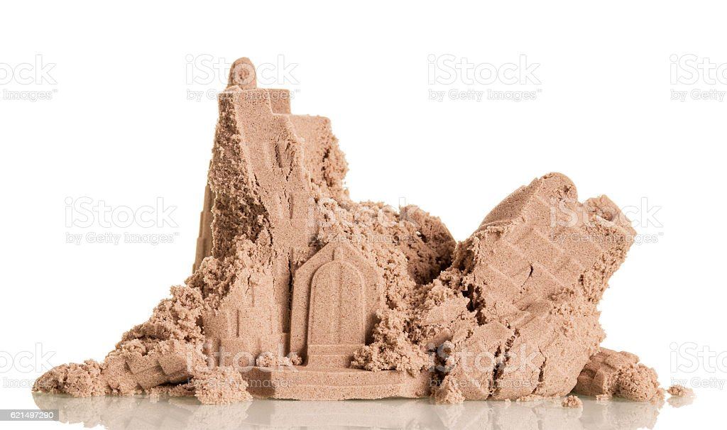 Ruined sand tower close-up isolated on white background. Lizenzfreies stock-foto