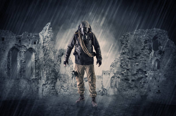 Ruined wallpaper with hazard man Hazard, menace man in a ruined crumbly building with arms on his hand bootes stock pictures, royalty-free photos & images