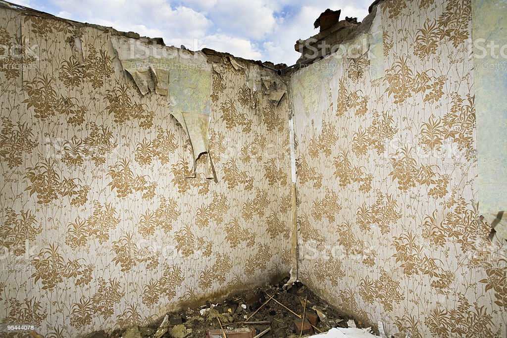 Ruined walls with retro wallpaper royalty-free stock photo