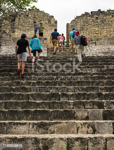 Kohunlich, Mexico – April 24, 2019: Tourists group visiting old ruin at the Mayan city of Kohunlich - large archaeological site of the pre-Columbian Maya civilization, the Yucatán Peninsulain, the state Quintana Roo, Mexico