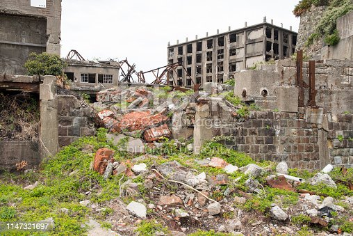 Hashima Island, Japan - 11 April 2019: Hashima Island-Gunkanjima meaning Battleship Island, is an abandoned island lying about 15 kilometers (9 miles) from the city of Nagasaki, in southern Japan. This is former coal mining island. It is old coal mine in Japan closed at 1974 due to the closure of coal mine.