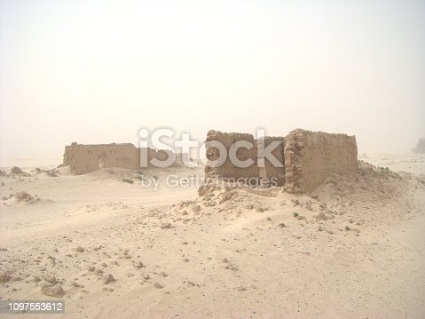 Ruins in the middle of Sahara desert during a sandstorm