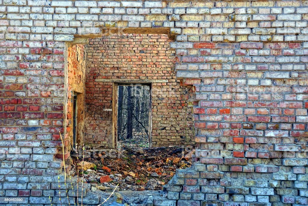 hole in the brick wall of an old abandoned house