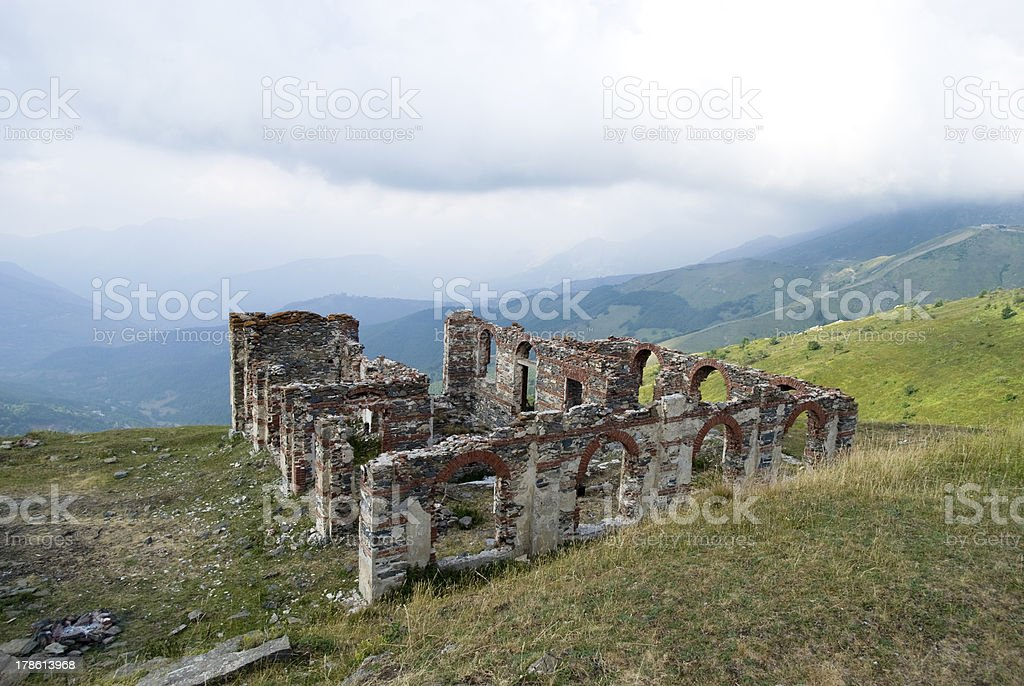 The remains of a small stone house in Alps mountains, Italy