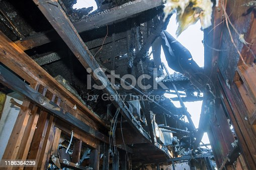 1015604978 istock photo Ruins of a destroyed residence after a house fire 1186364239