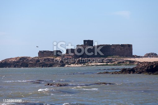 Ruins of a fort on an islet of the Iles Purpuraires, a set of small islands off the western coast of Morocco at the bay located at Essaouira.