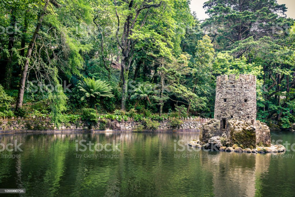 Ruins of a medieval tower in lake near Pena Castle in Sintra, near Lisbon, Portugal Ruins of a medieval tower in lake near Pena Castle in Sintra, near Lisbon, Portugal Capital Cities Stock Photo