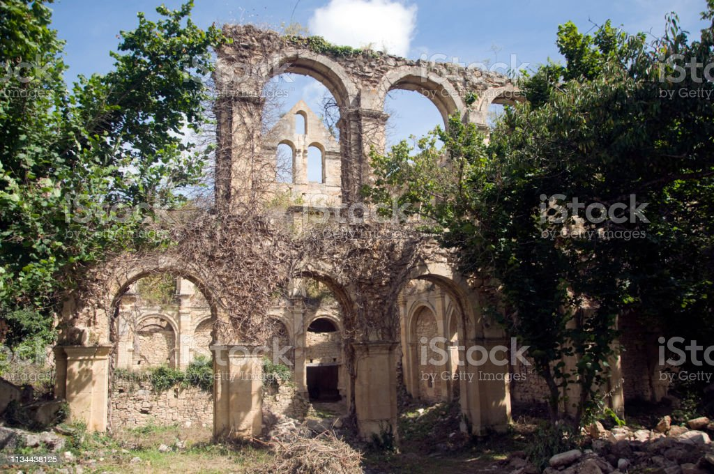 ruins of an abandoned medieval church stock photo