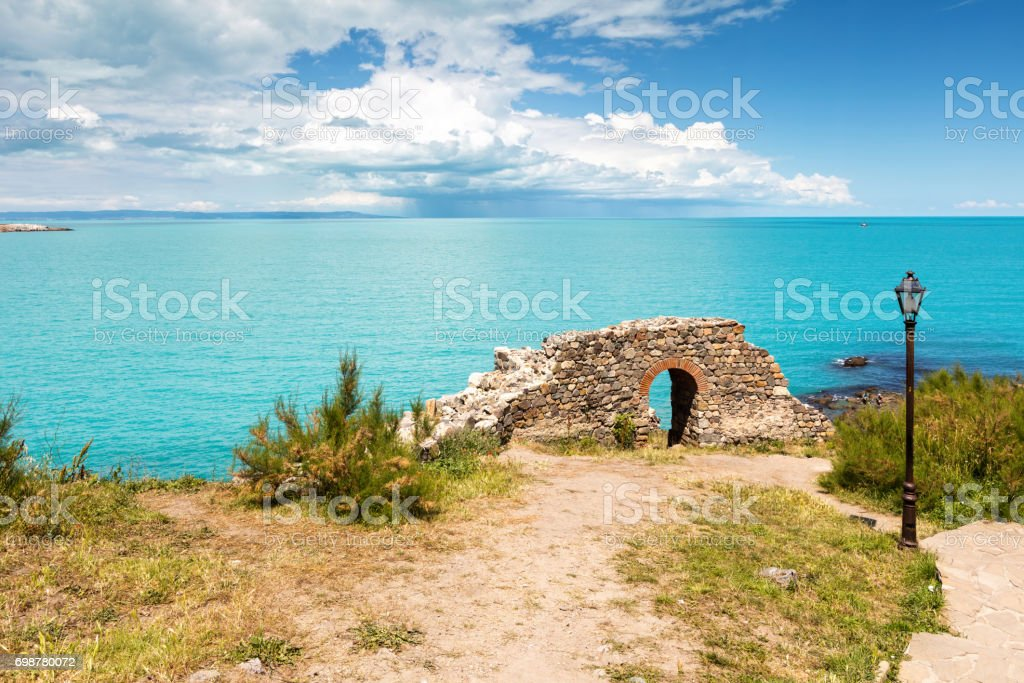 Ruins of an ancient fortress by the sea stock photo