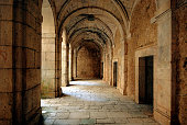 The corridor around the courtyard of a deserted, old monastery near Lerma in Spain
