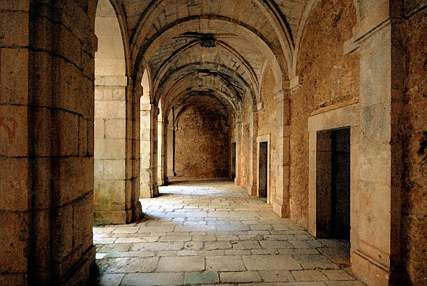 Ruins of an ancient monastery The corridor around the courtyard of a deserted, old monastery near Lerma in Spain abbey monastery stock pictures, royalty-free photos & images