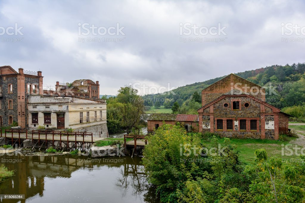 Ruins of an ancient stone mill. Stone wall of the old mill of granite...