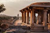 istock Ruins of an ancient temple in Hampi, Karnataka, India 870735406