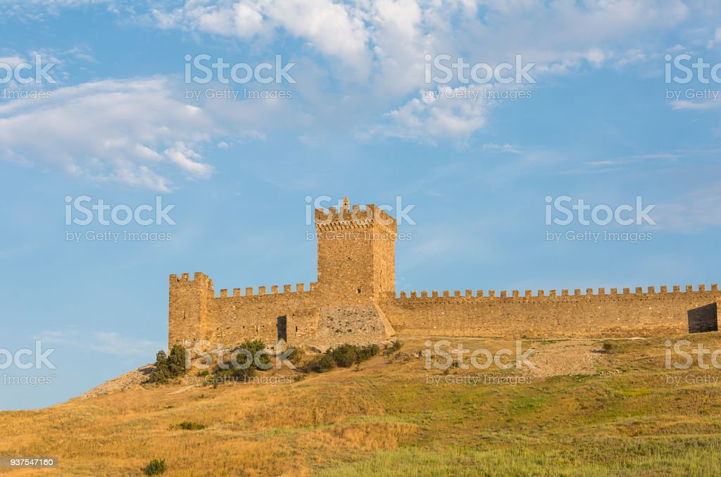 Krym Sudak ruins of an old fortress on a green hill, with a piece of...