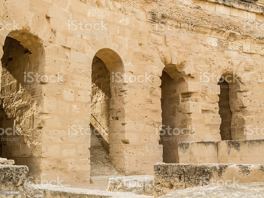 ruins of ancient colosseum in North Africa stock photo