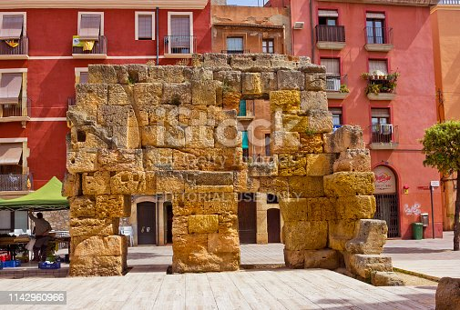 Tarragona, Spain - April 25, 2018:  Ruins of ancient Roman edifice with few people nearby