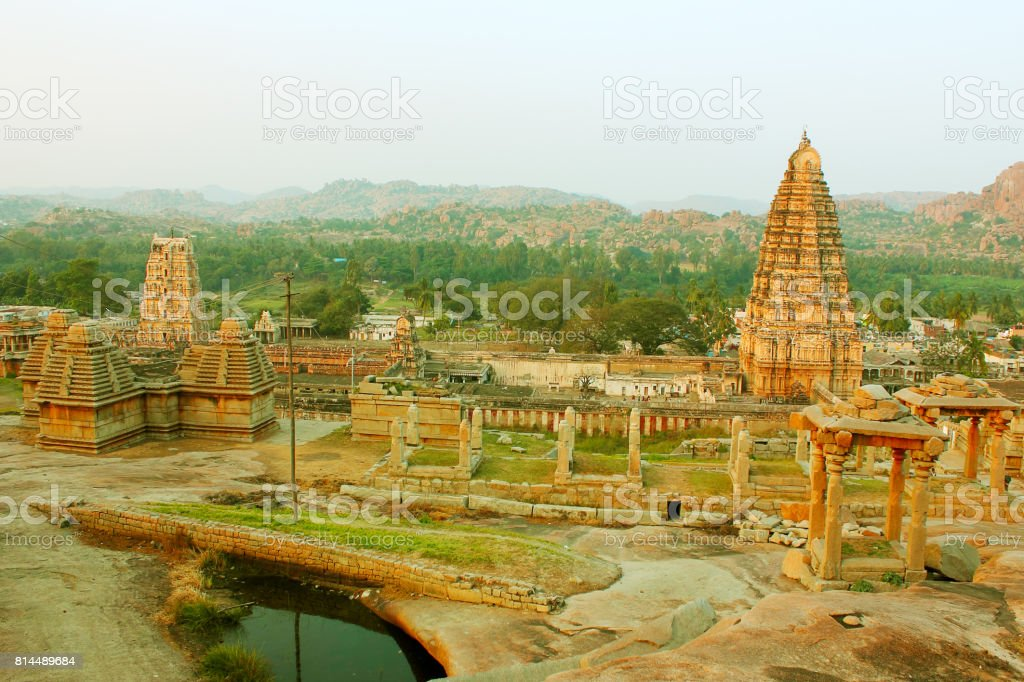 Ruins of ancient temples with Virupaksha temple in Hampi, India stock photo