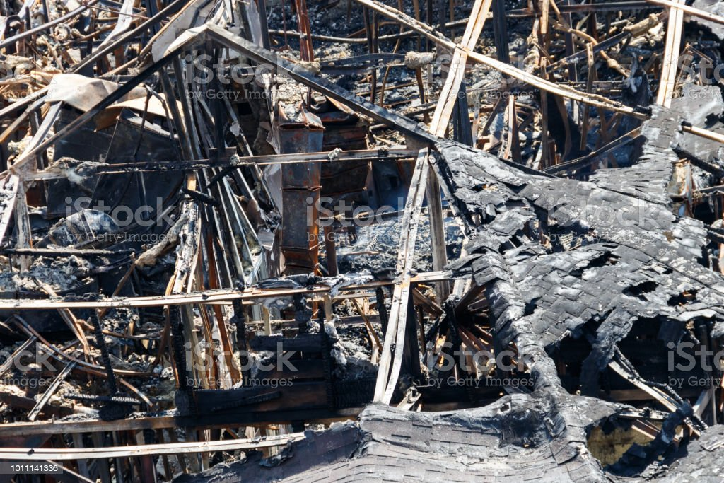 Ruins of building after the fire. Close-up at the site of the disaster stock photo