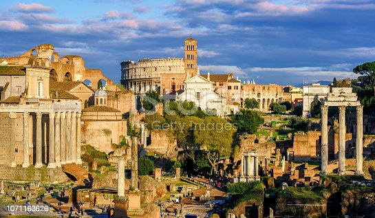 Ruins of ancient Forum Romanum, the center of the antique Roman Empire, and the Colosseum in Rome, Italy