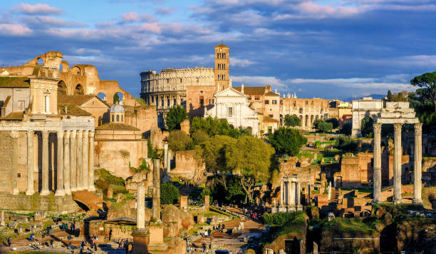 Ruins of Forum Romanum and Colosseum, Rome, Italy Ruins of ancient Forum Romanum, the center of the antique Roman Empire, and the Colosseum in Rome, Italy unesco stock pictures, royalty-free photos & images